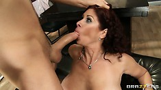 Stacked redhead rides on a dick before taking it in her mouth