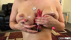 Naughty hottie Krissy Lynn oils up her melons and gives a titty fuck to her dildo