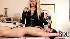 The slave gets hot wax poured on her and is whipped by a crop