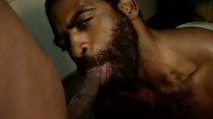 Tough looking black guys indulge in some naughty cocksucking