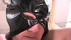 Dominant masked guy gets a young boy toy to suck on his hard dick